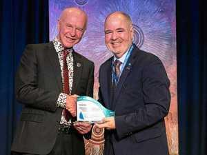 Former school principal wins highest honour