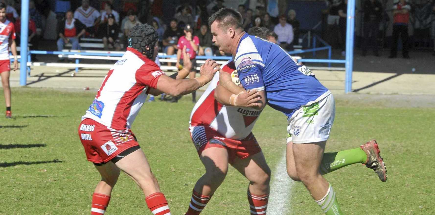 PHYSICAL BATTLE: Ghosts forward Jarrad Day takes on the Rebels defence in the reserve grade derby earlier in the year.