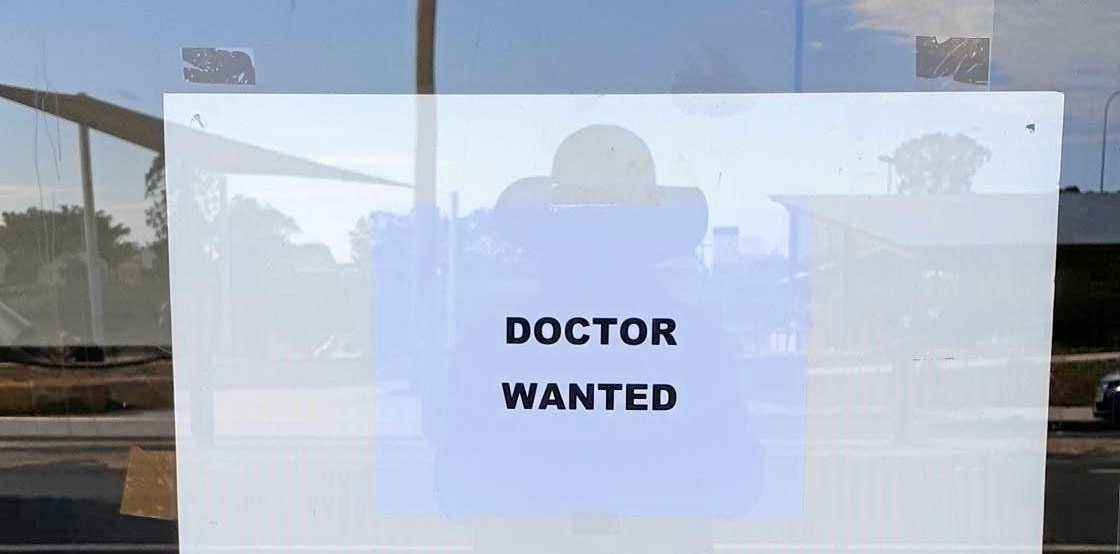 DOCTOR WANTED: Posters on the empty shop in River St in Woodburn.