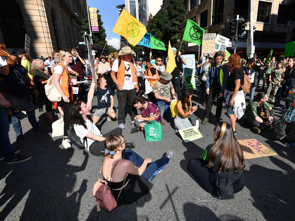 Extinction Rebellion protesters also blocked the road on Edward and Queen streets on Tuesday in a bid to shut down the CBD. Picture: AAP