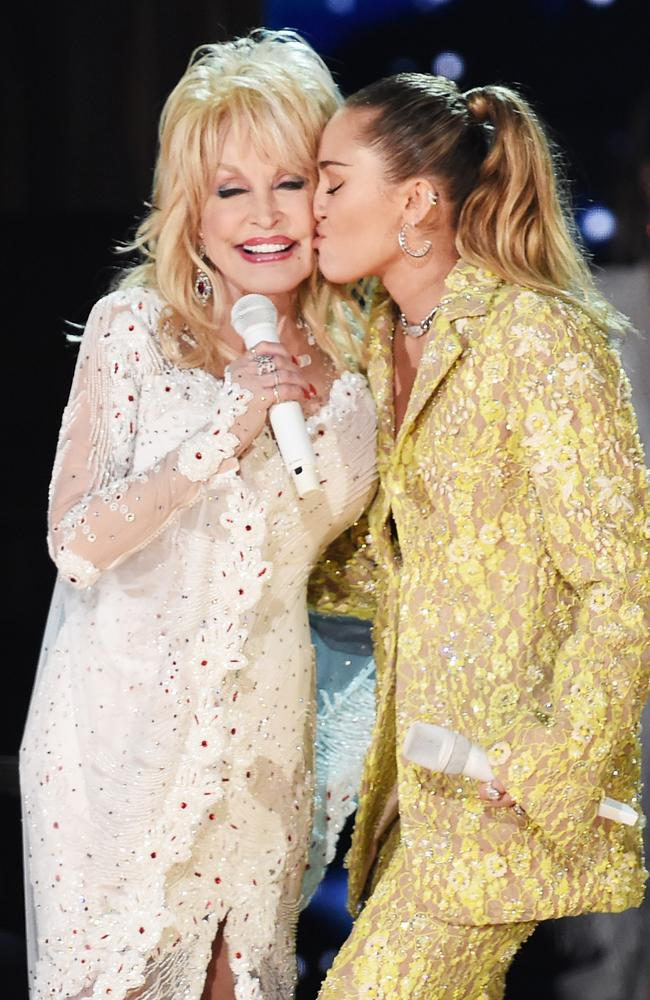 Dolly Parton and Miley Cyrus perform onstage during the 61st Annual Grammy Awards. Picture: Kevin Winter/Getty Images