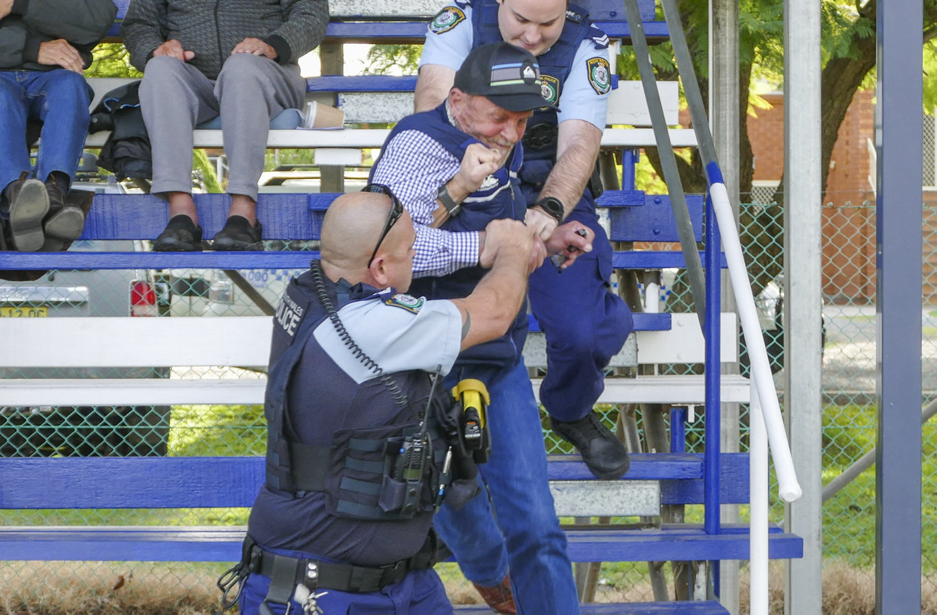 Football commentator Dougie Graham arrested by police during the Grafton Ghosts game