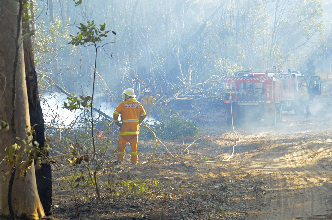 Clarence Valley Rural Fire Service crews battle to put out a spot fire that jumped containment lines of an out of control bushfire at Whiteman Creek west of Grafton on Saturday, 10th August, 2019.