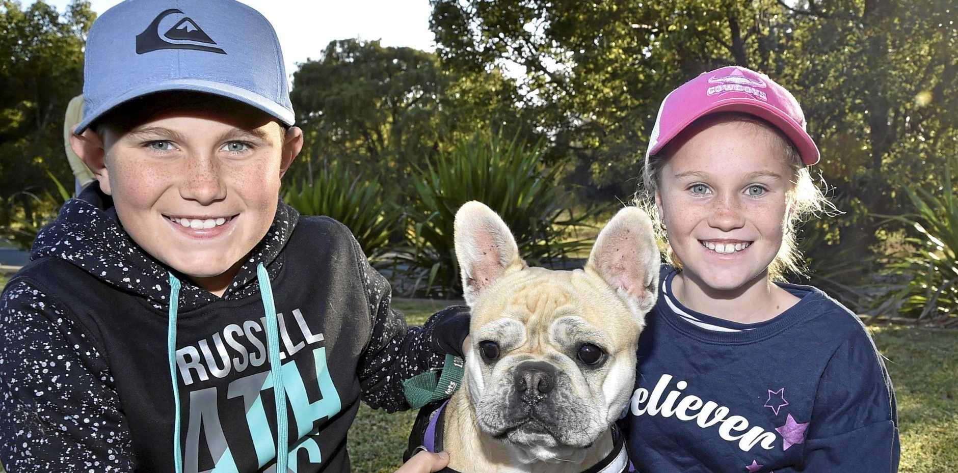 Flynn and Addyson Edards enjoy the Willows Walkies event with their beautiful dog, Hazel.