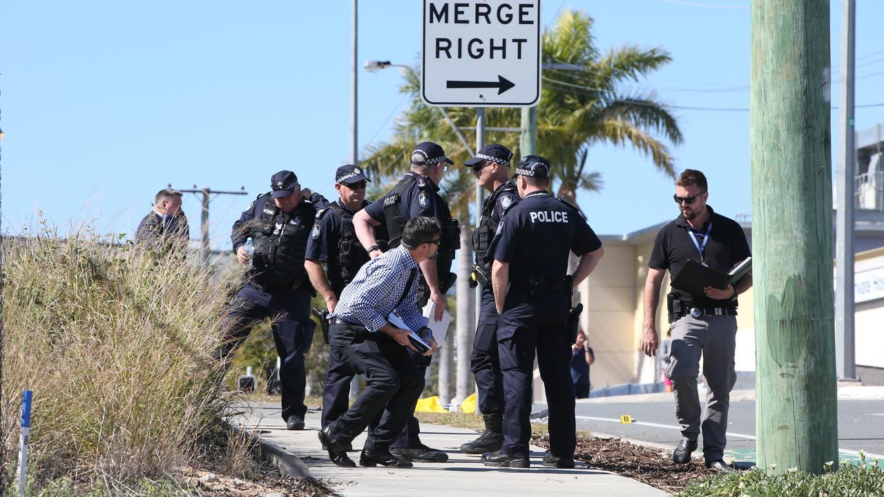 Police investigate the crash. Picture Glenn Hampson