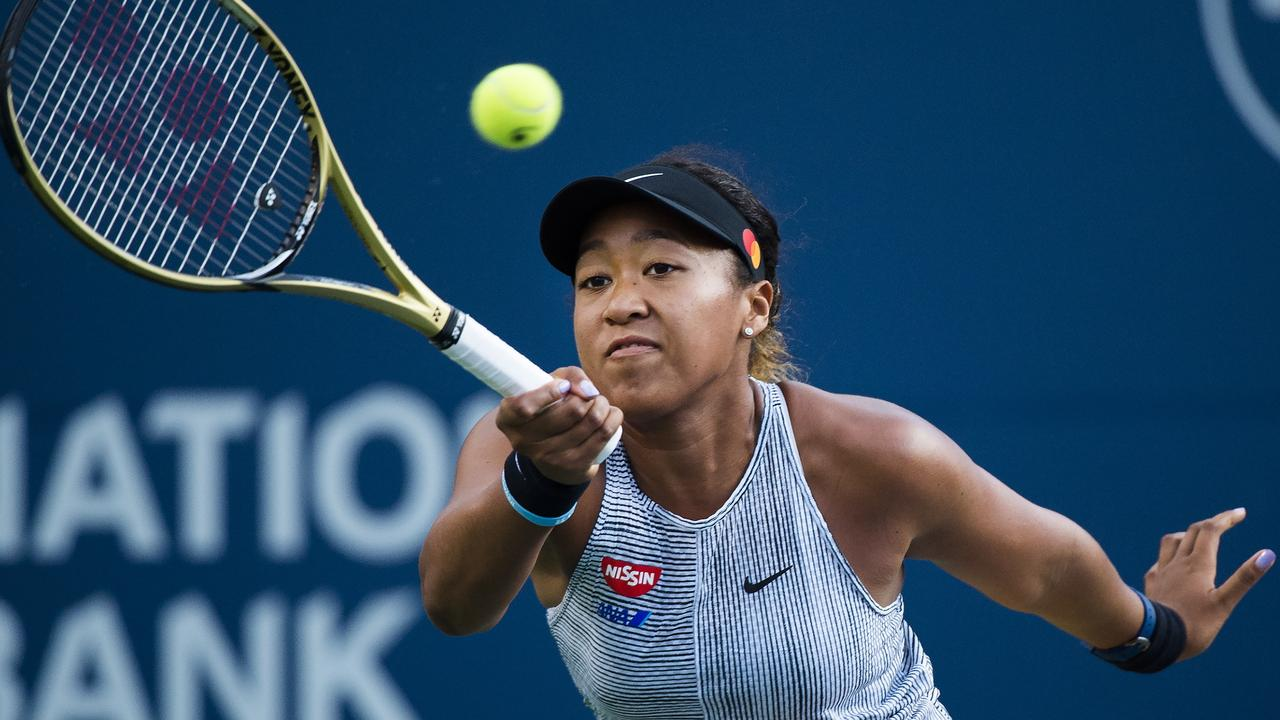 Naomi Osaka hits a forehand against Serena Williams. Picture: Nathan Denette/The Canadian Press