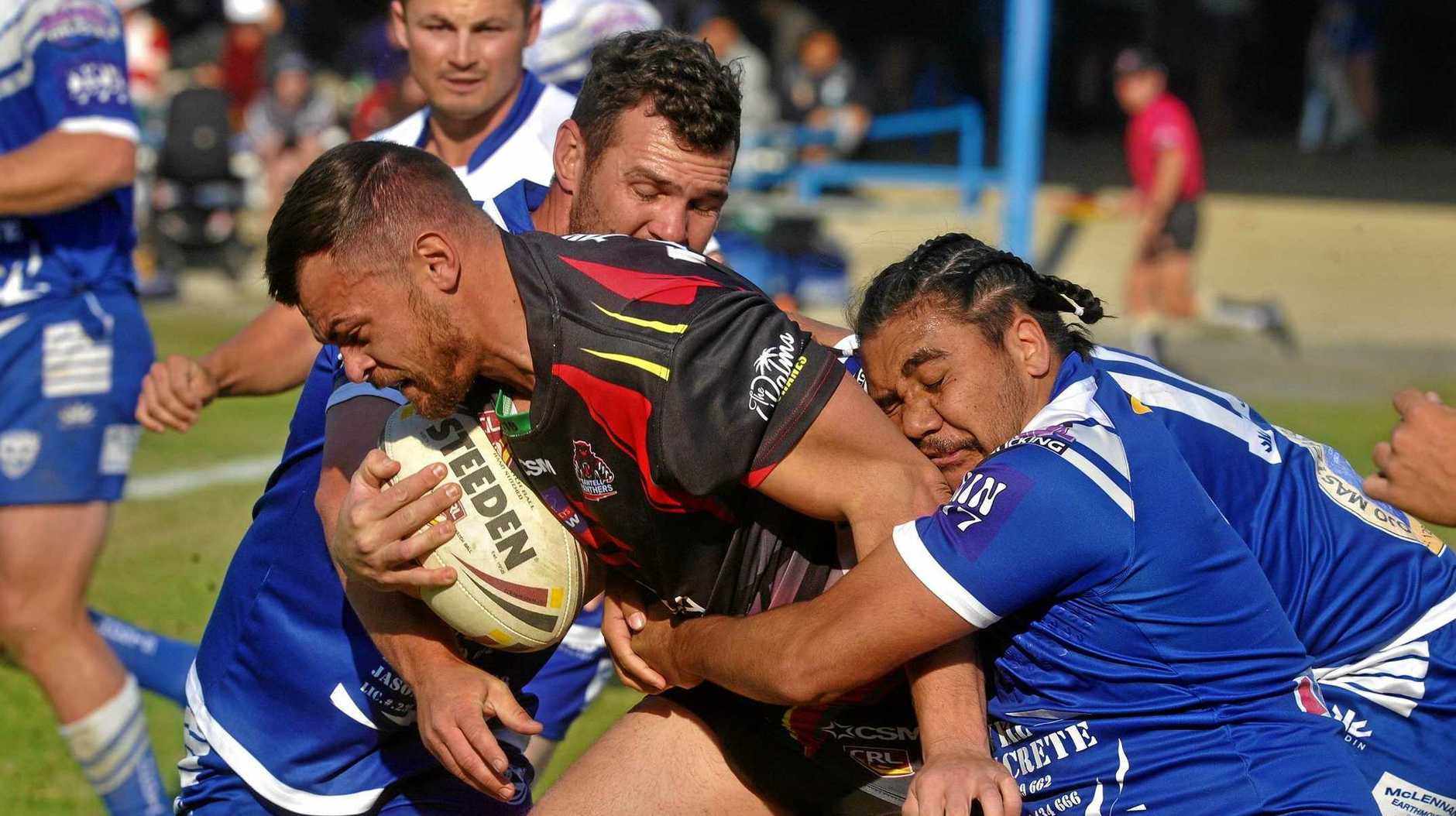 SMOTHERED: Ghosts men Vincent Williams and Todd Cameron tackle Sawtell Panther Daniel Donovan at Frank McGuren Field in the preliminary final on Sunday.