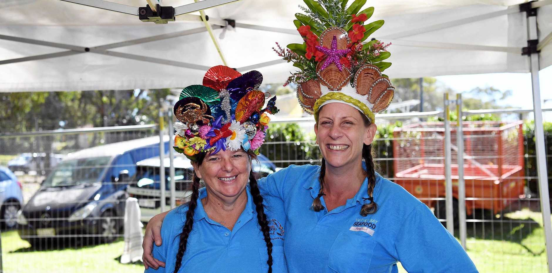 Kerry Tatchell and Jane Lamont wearing clam hats made by event organiser Elaine Lewthwaite at the Hervey Bay Seafood Festival on Saturday
