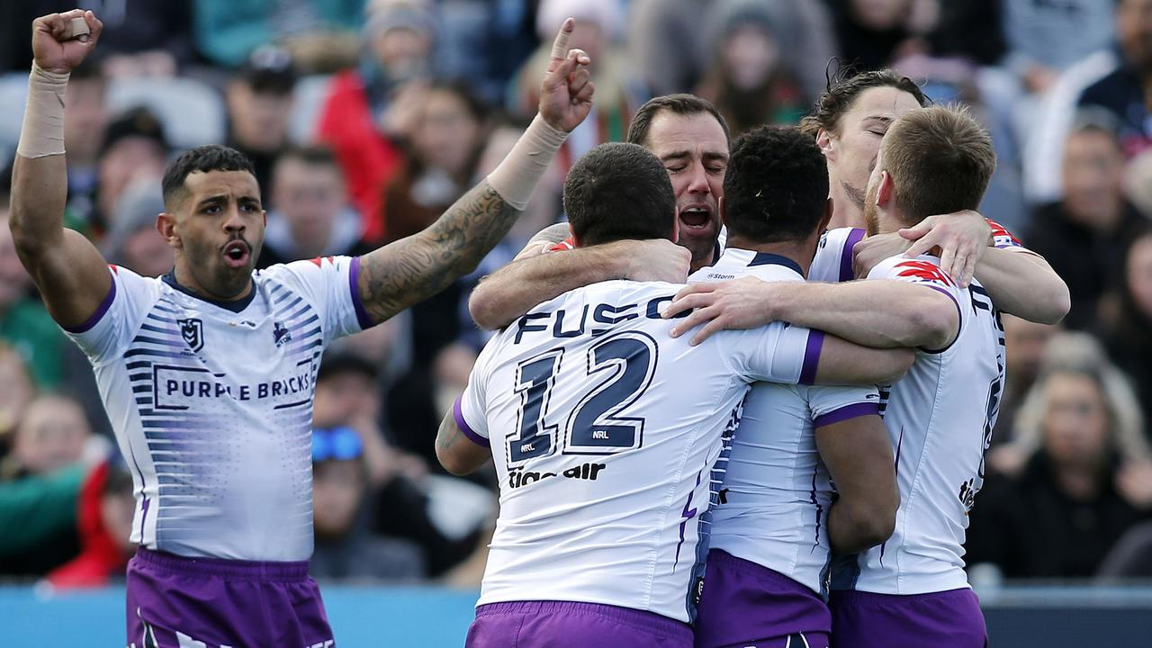 Justin Olam celebrates a try with his Storm teammates. Picture: AAP