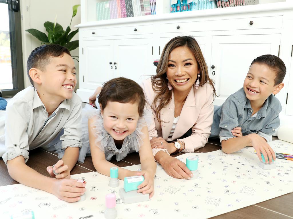 Sydney business woman, Uyen Maxwell with her kids Jayden 11, Ryan 9 and Jessica 5. Picture: Tim Hunter.