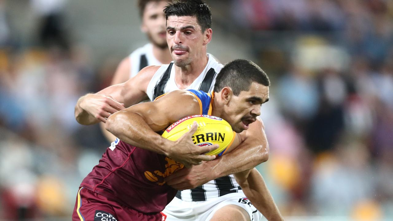 Charlie Cameron is tackled by Scott Pendlebury during the Lions' loss to Collingwood in Round 5. Picture: Getty Images