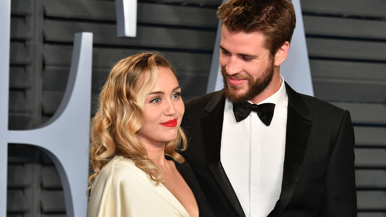 FILE: Miley Cyrus, Liam Hemsworth Separate 2018 Vanity Fair Oscar Party Hosted By Radhika Jones - Arrivals