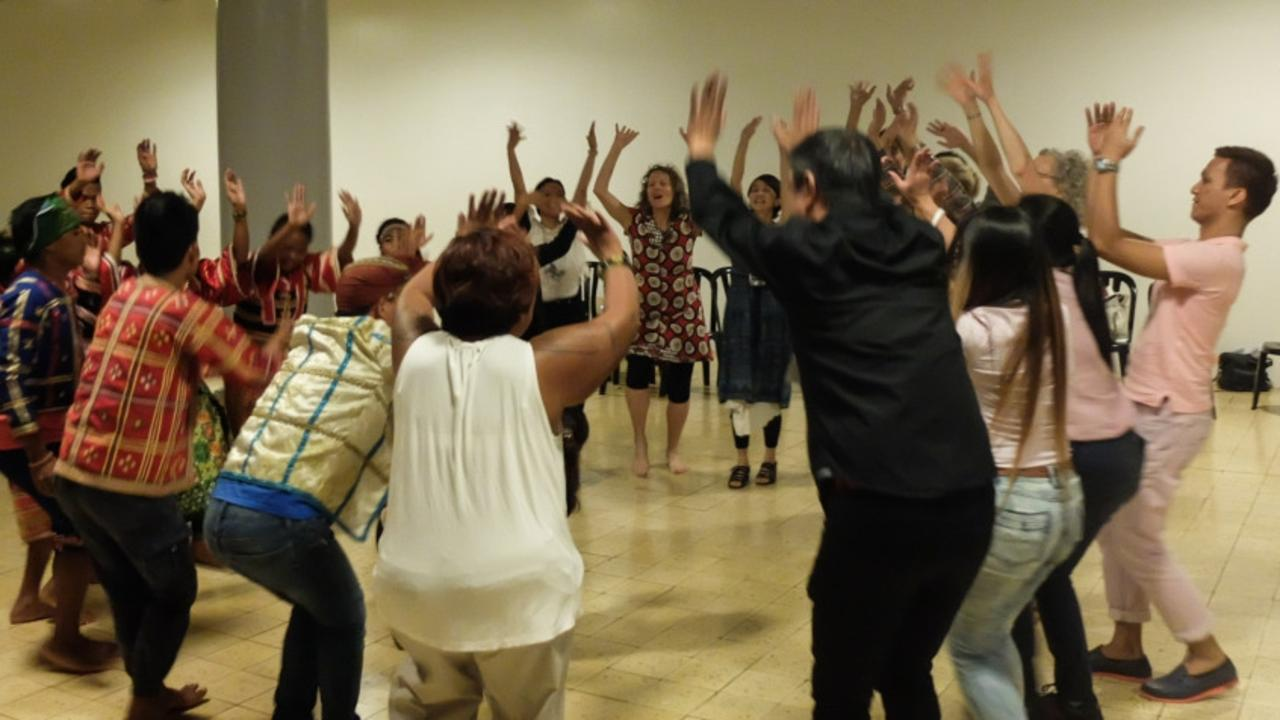 Delegates learn a dance at the Performance Curators Initiatives Symposium in the Philippines.