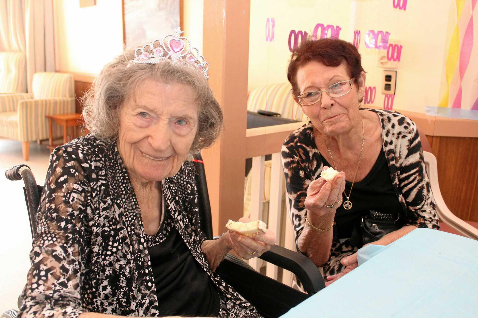 Lorna Craney and daughter Karen Holland enjoy birthday cake.