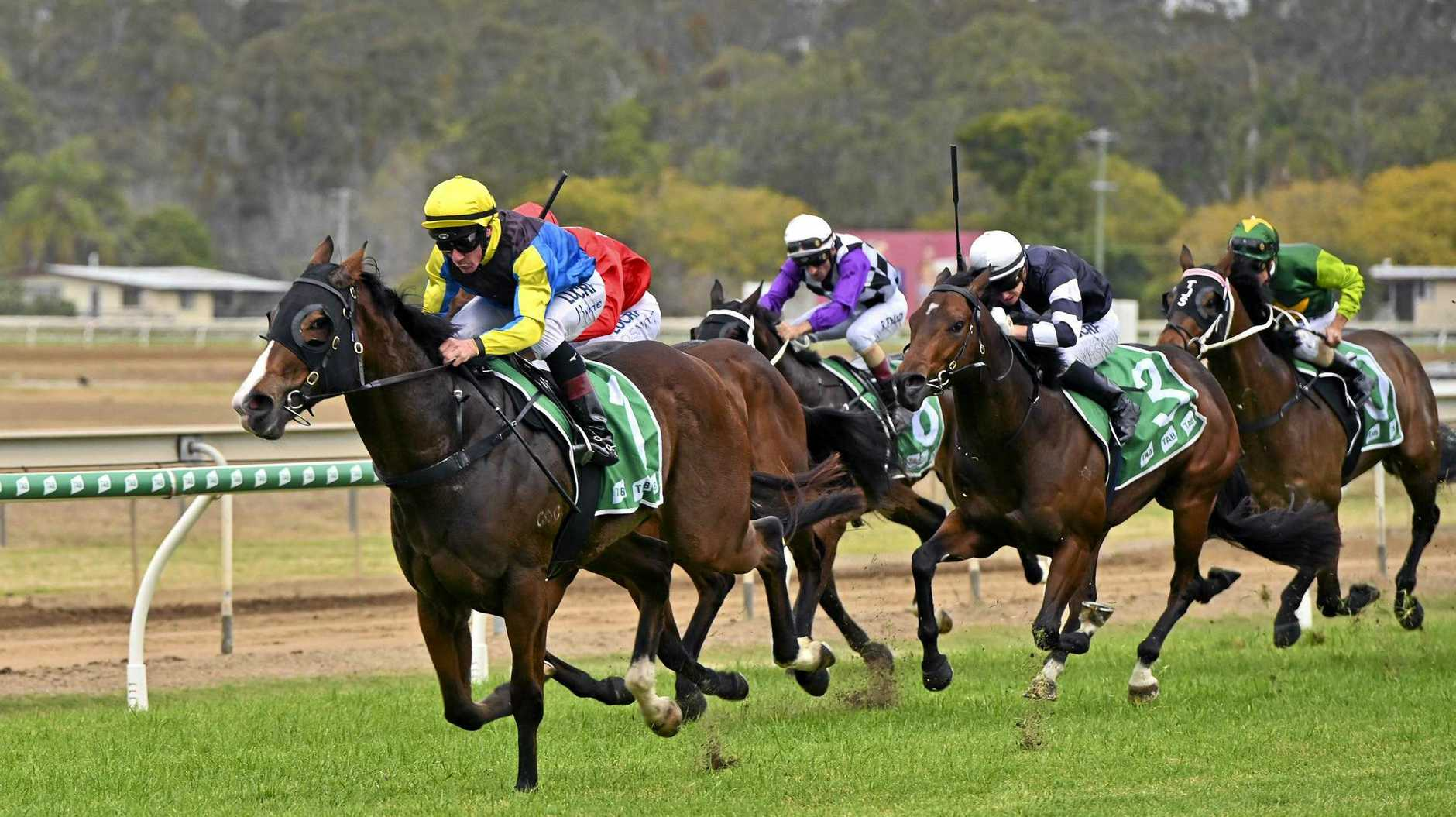 LEADING RUN: Jockey Jim Byrne guides Baby Boomer home at Ipswich racetrack.