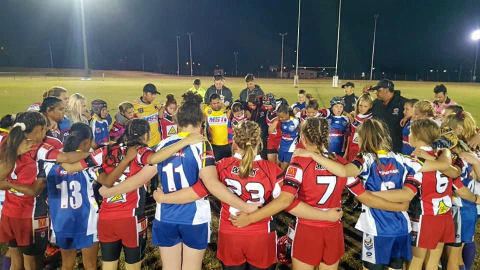 South Burnett Eagles and Valleys observe a minutes silence before their game.