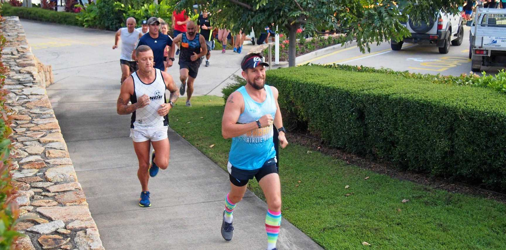 BRIGHT TIME: Justin Knight-Gray (right, leading James Henry) was a great example of the colourful socks sported by those at Airlie Beach parkrun last Saturday as the event celebrated 200 editions.