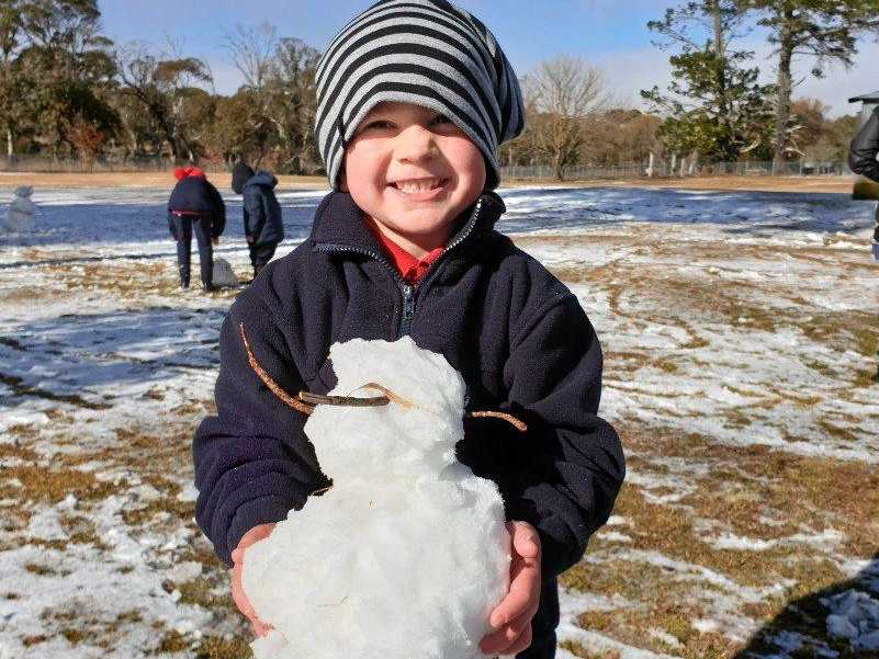 Five-year-old Myles Cook of Ebor makes the most of the snow the village received overnight.