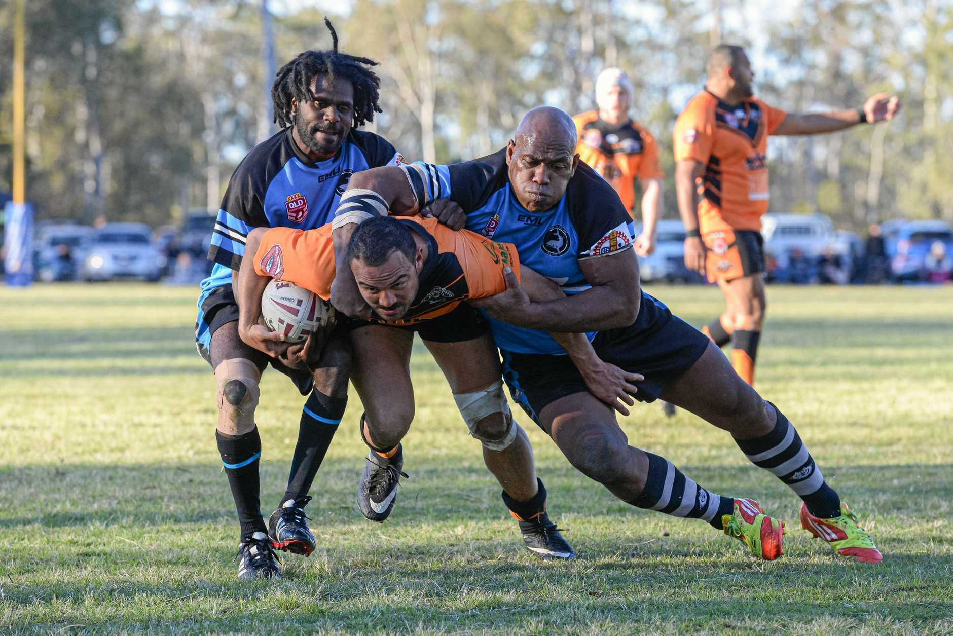 Avondale's Malcolm Lambell is tackled by Graham Jones and Serupepeli Natui.