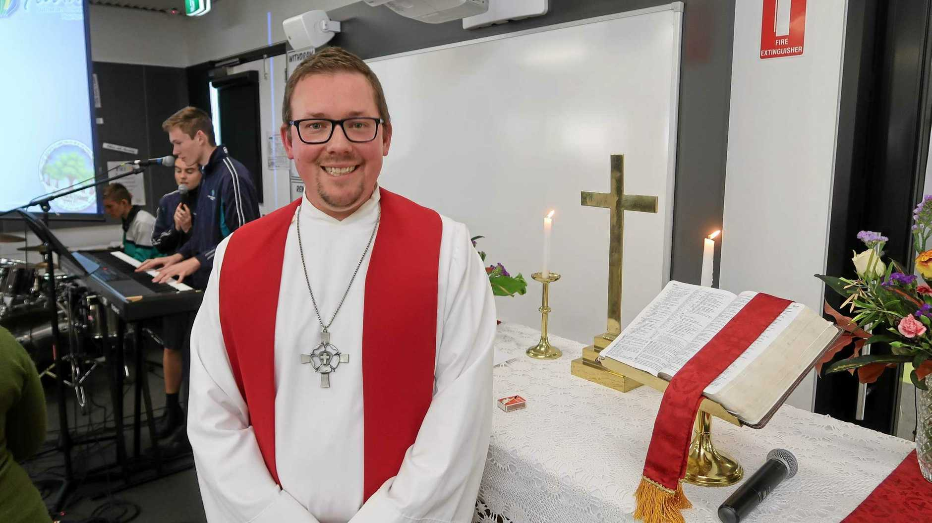 WELCOME: Luke Spilsbury is sworn in as pastor at Faith Lutheran College.
