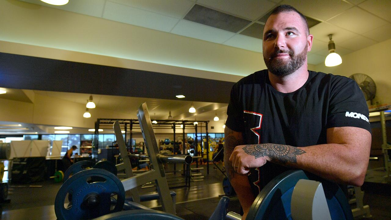 FIGHTING FIT: Sam Hambly is getting his life back to normal in the gym after he suffered a rare paralysis disease. Photo: John McCutcheon