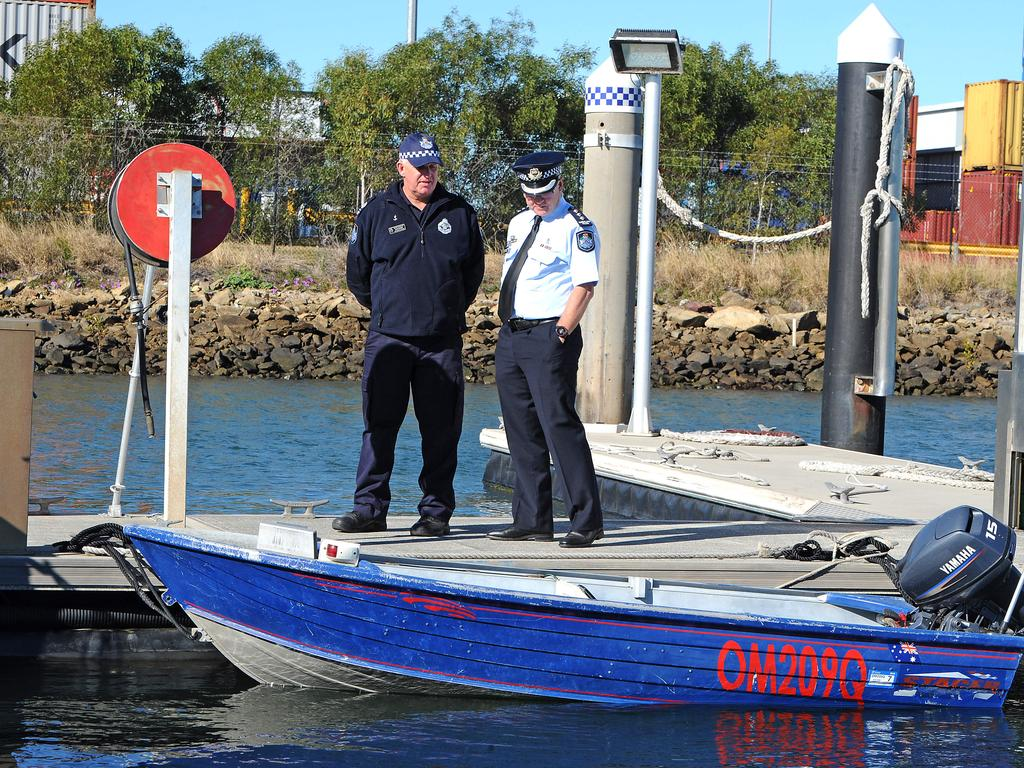 Senior Sergeant David Edden and Inspector Lindsay Kilpatrick with the missing fishermen's boat. Picture: John Gass/AAP