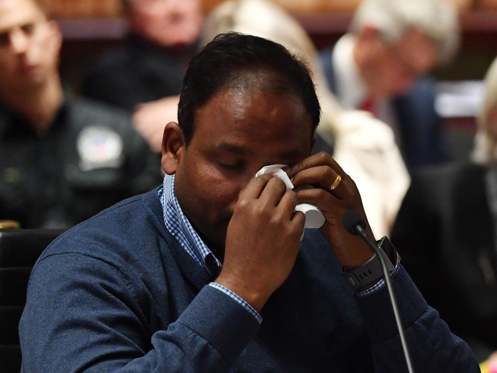 An emotional Vijay Vital, who owns a unit in Mascot Towers, wipes away tears after delivering his opening statement to the inquiry. Picture: AAP/Dean Lewins