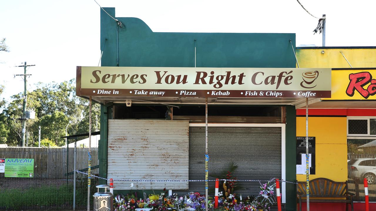 Floral tributes laid at the front of the cafe in the days after the 2015 blast. PICTURE: BRENDAN RADKE