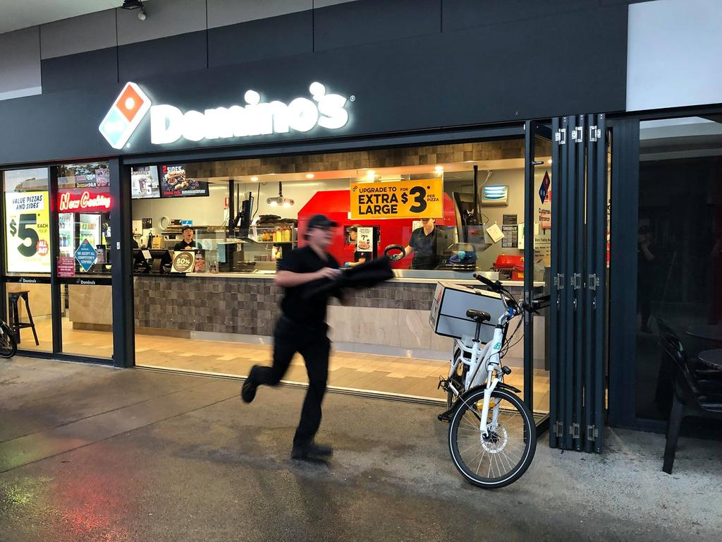 A Domnio's worker running to deliver the record breaking pizza. Picture: Supplied