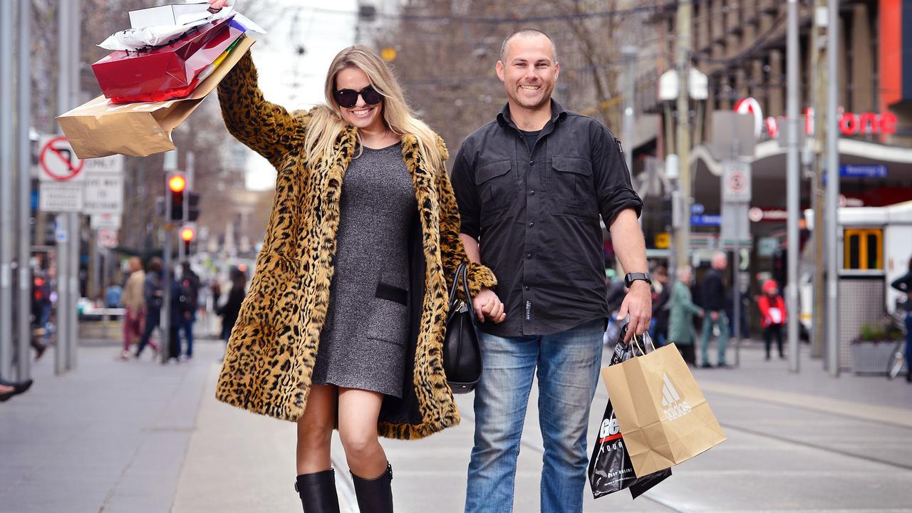 Natalia Kopocinski and Martyn Radziszewski shop in the Bourke Street Mall. Picture: Nicki Connolly