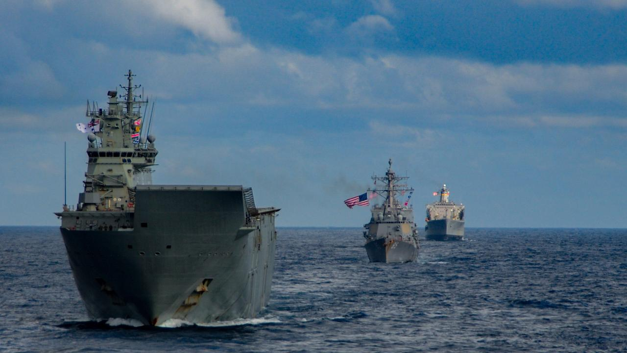 HMAS Canberra (front) during operation Talisman Sabre. Picture: ADF/US Navy