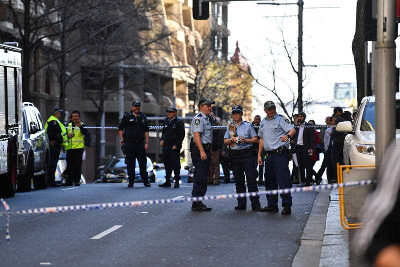Police are seen during a police operation at the corner of King and York Street in Sydney, Tuesday, August 13, 2019.