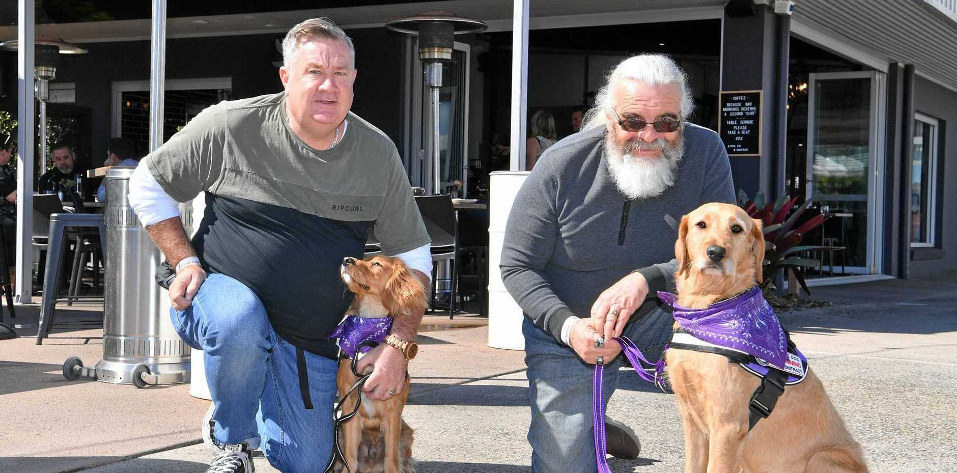 Andrew Harris and Roger Weeks at Riba Kai with rescued dogs that they train to assist those affected by PTSD.