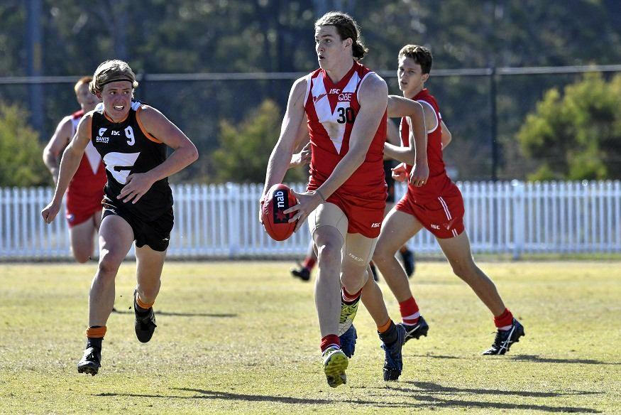 IN MOTION: Hamish Ellem runs the ball for the Sydney Swans Academy.