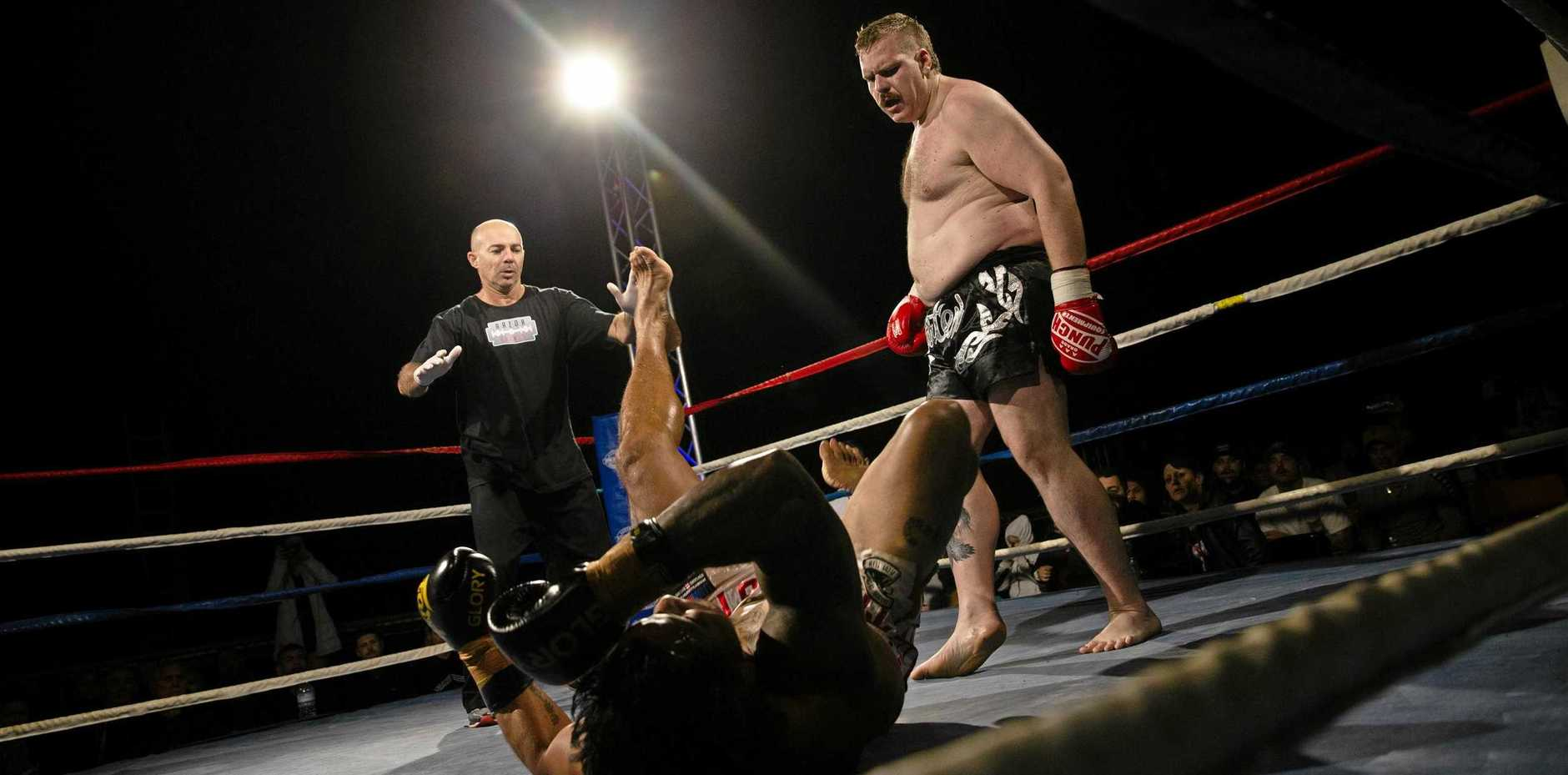 BIG HIT: Rockhampton's Joshua Crank floors Stanley Tuionuku in the super heavyweight division at Rocky Rumble 2019 Part II at Callaghan Park on Saturday night.