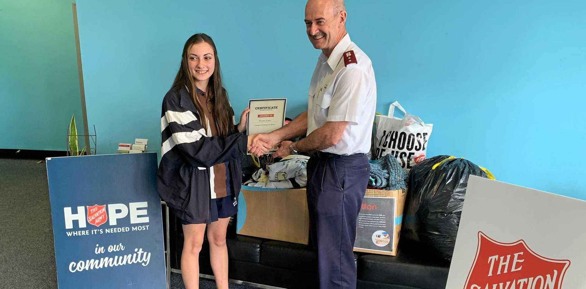 GOOD DEED: Phoebe Sutton donates clothes for the less fortunate.