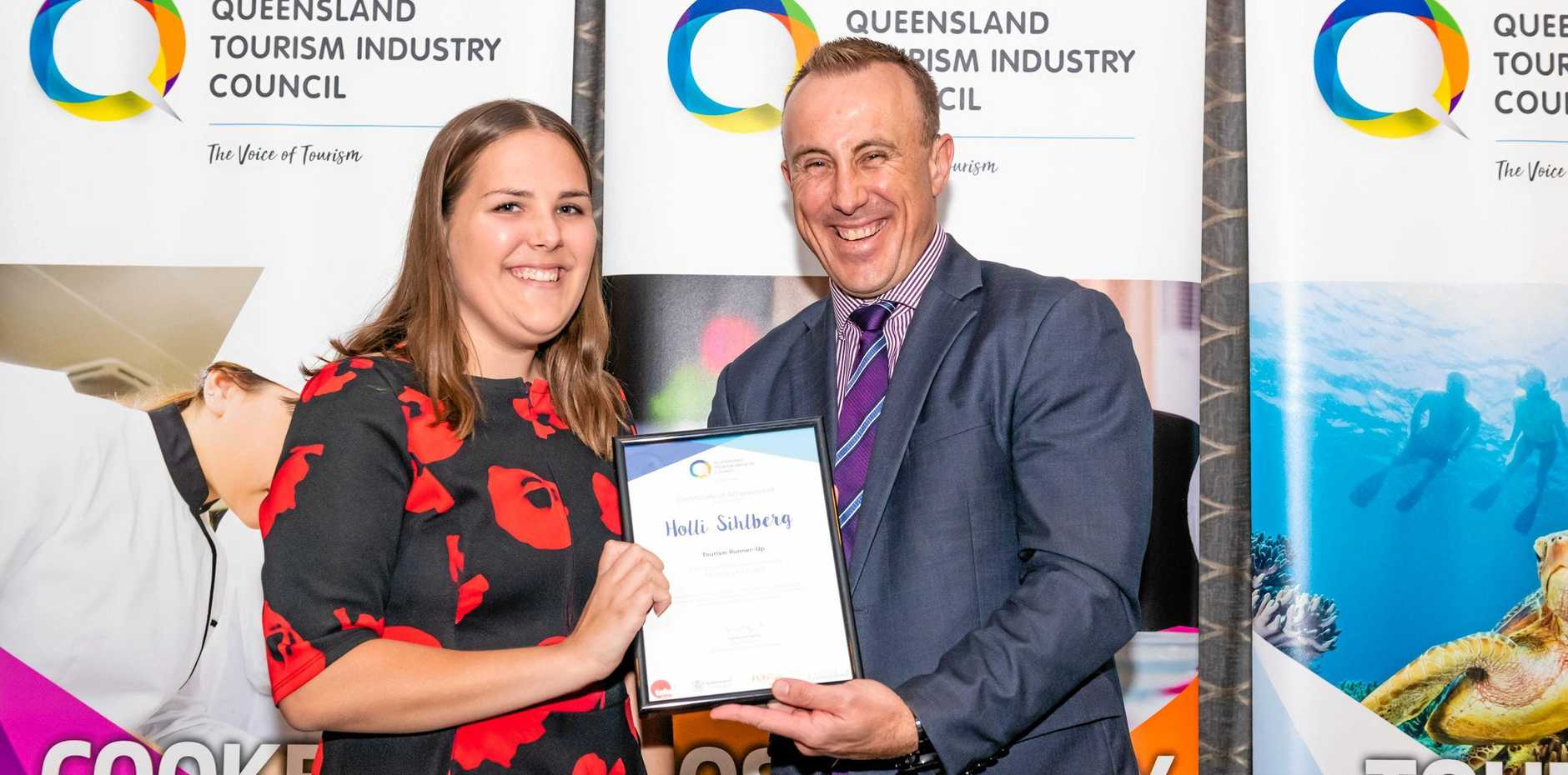 RUNNER-UP: Holli Sihlberg receives Runner-Up in Tourism at the QTIC Salute to Excellence Awards, presented by Steve Koch, Department of Education, Training and Employment.