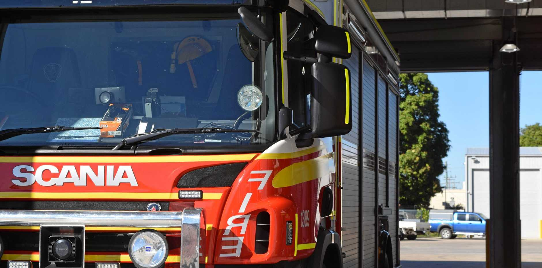 A QFES crew is monitoring an area near Harvey Road after a fire broke out yesterday.