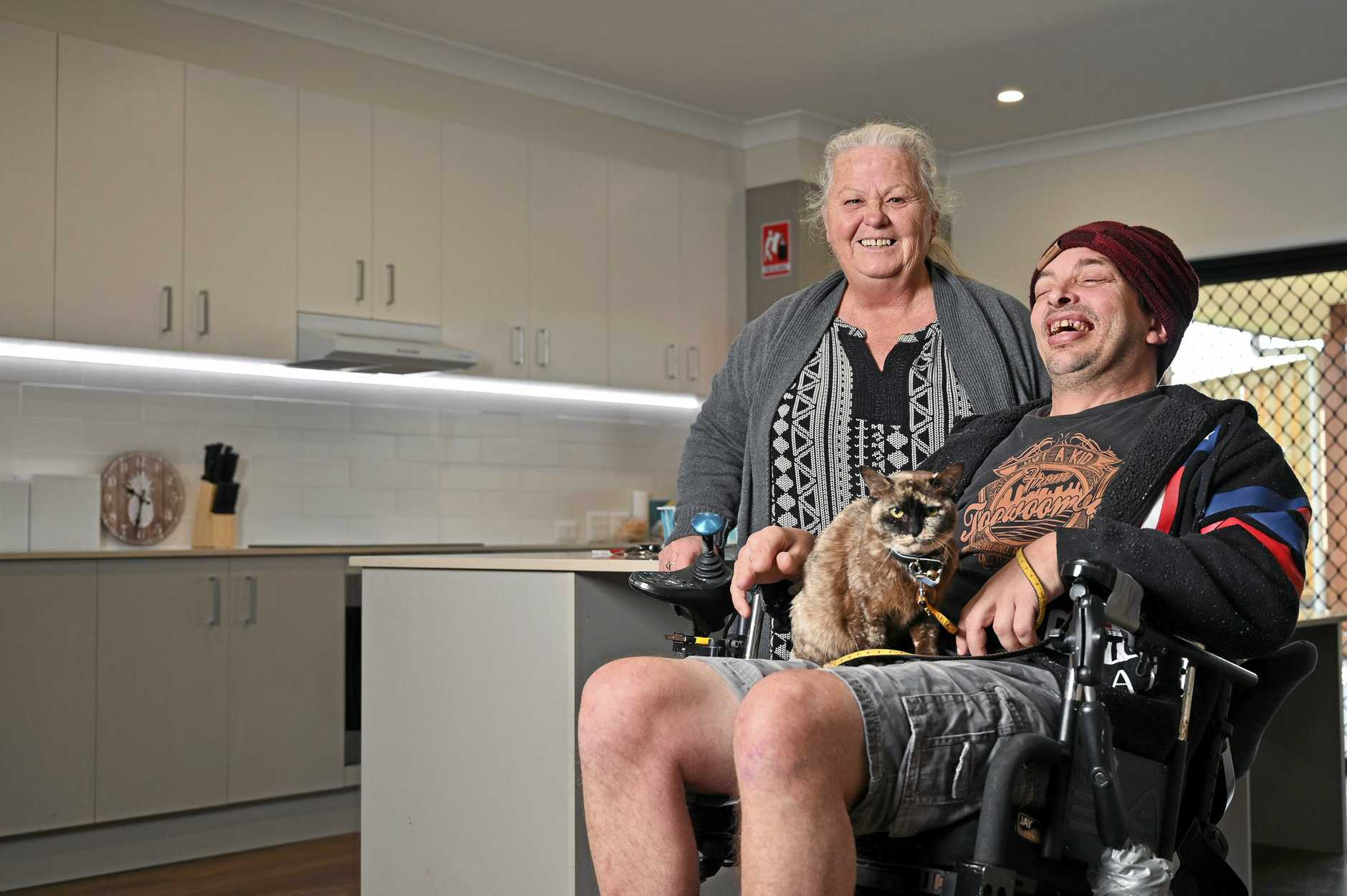 ALL SMILES: Support worker Jenny Cowan with Steven Warrington-Wood and his cat Millie.