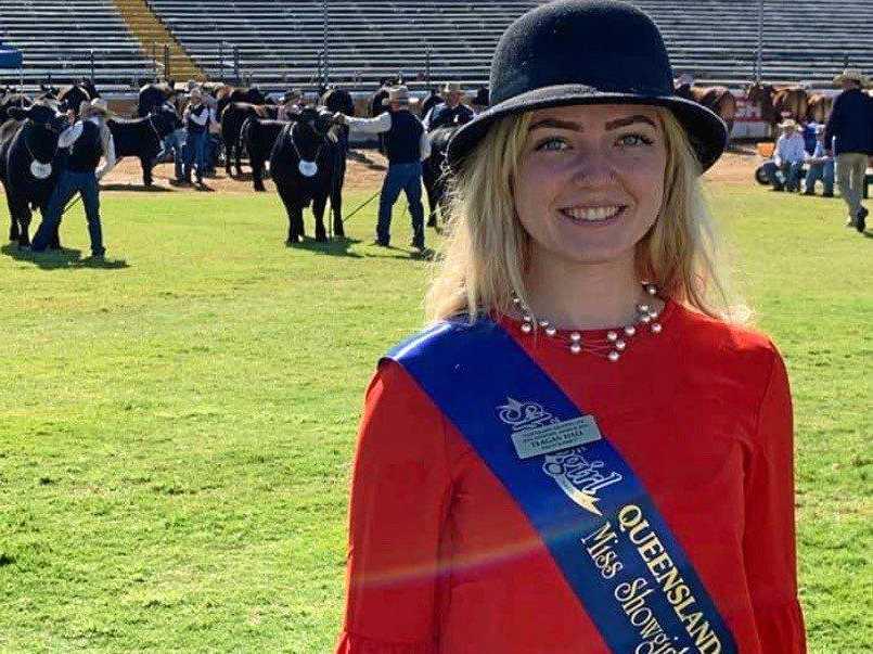 SHOW RING: South Burnett Miss Showgirl Teagan Hall helped sash cattle in the 2019 Brisbane Ekka cattle ring.