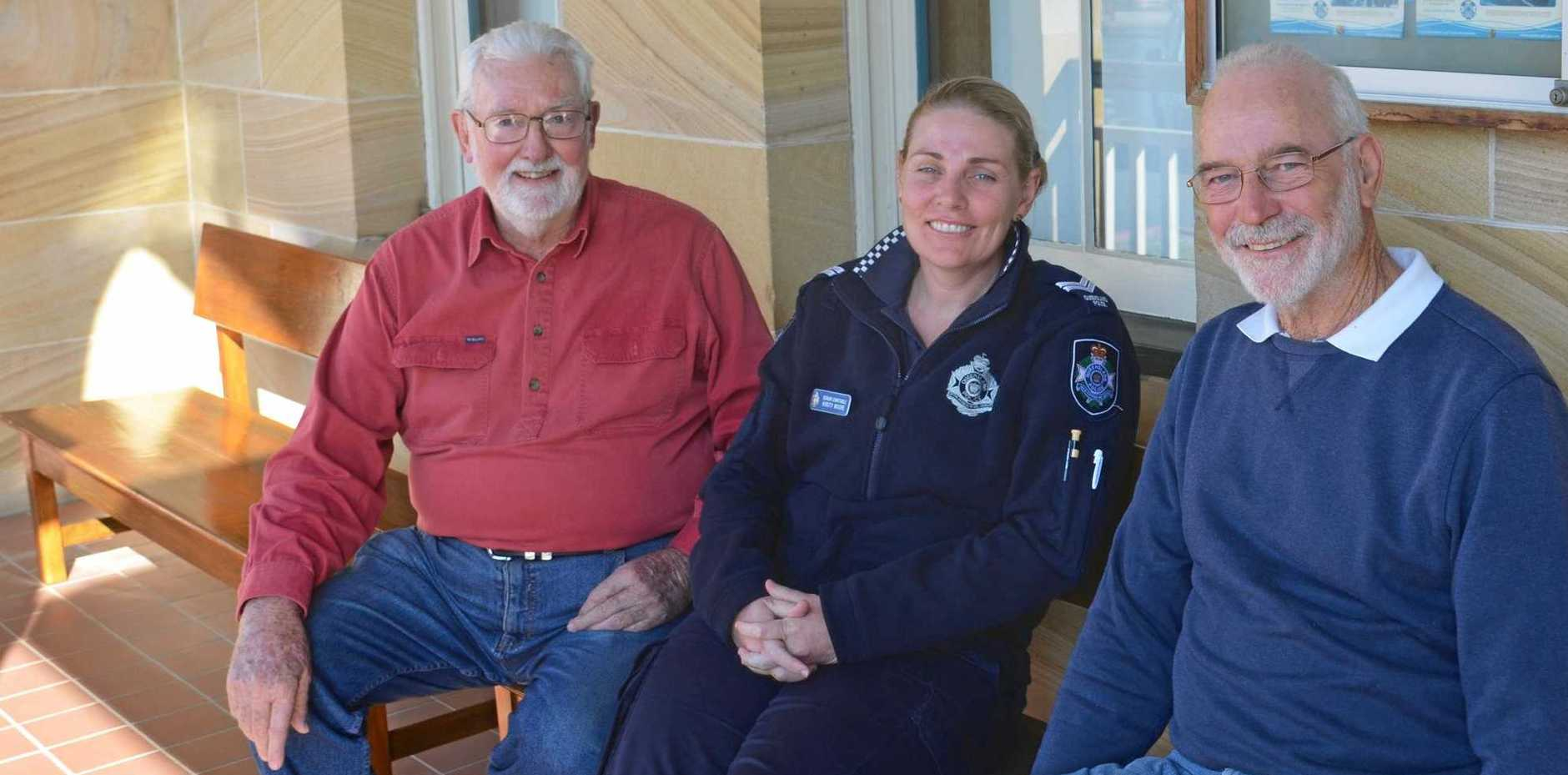 GOOD AS NEW: Warwick Men's Shed members Ian Stevens (left) and John Fogarty (right) were happy to help out police officers like Kirsty Moore.