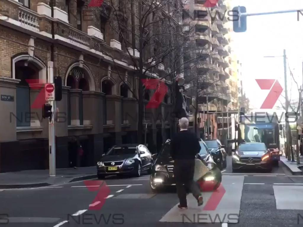 Another shot of the bystander holding his chair. Picture: Seven News