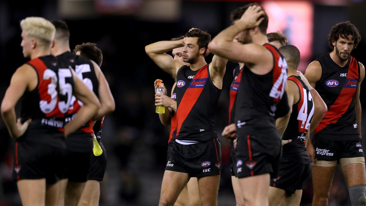 Essendon players come to terms with their heavy loss in Round 21. Picture: AAP Image/Mark Dadswell.