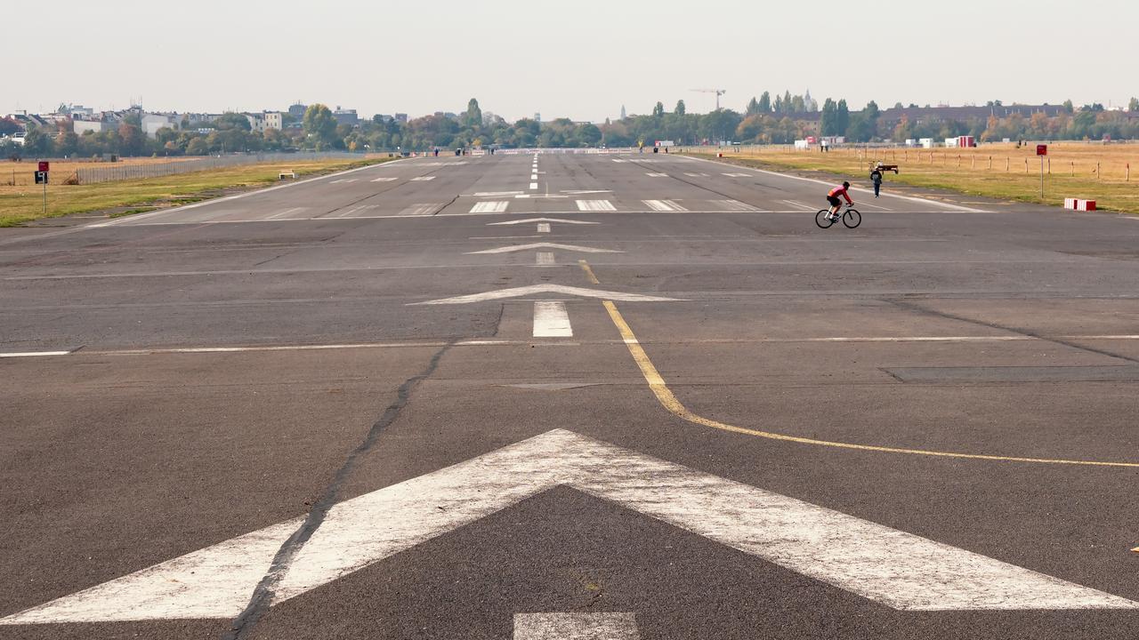 Former takeoff runway in public city park Tempelhofer Feld, former Tempelhof Airport in Berlin, Germany
