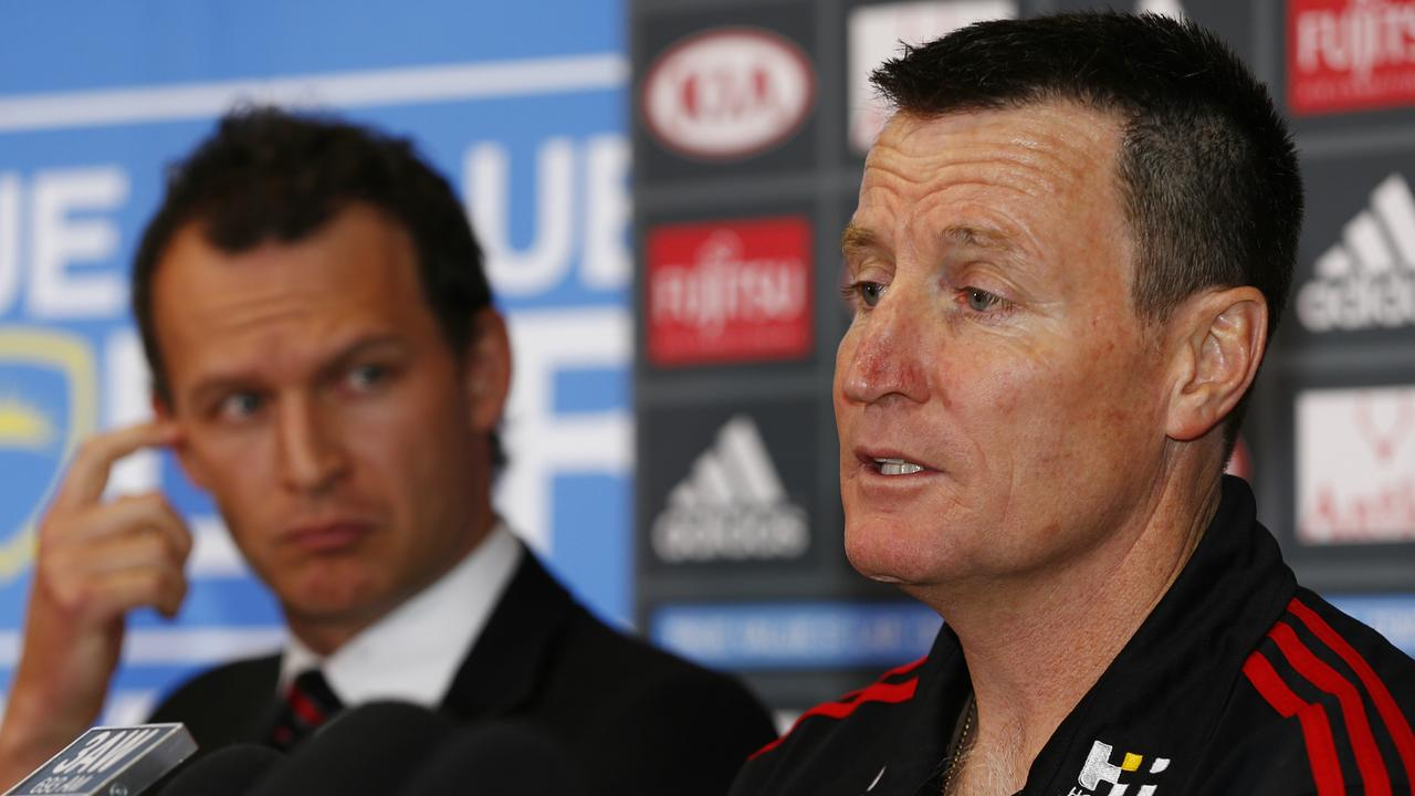 Essendon CEO Xavier Campbell looks on as John Worsfold addresses reporters following his appointment as coach in 2015. Picture: Michael Klein