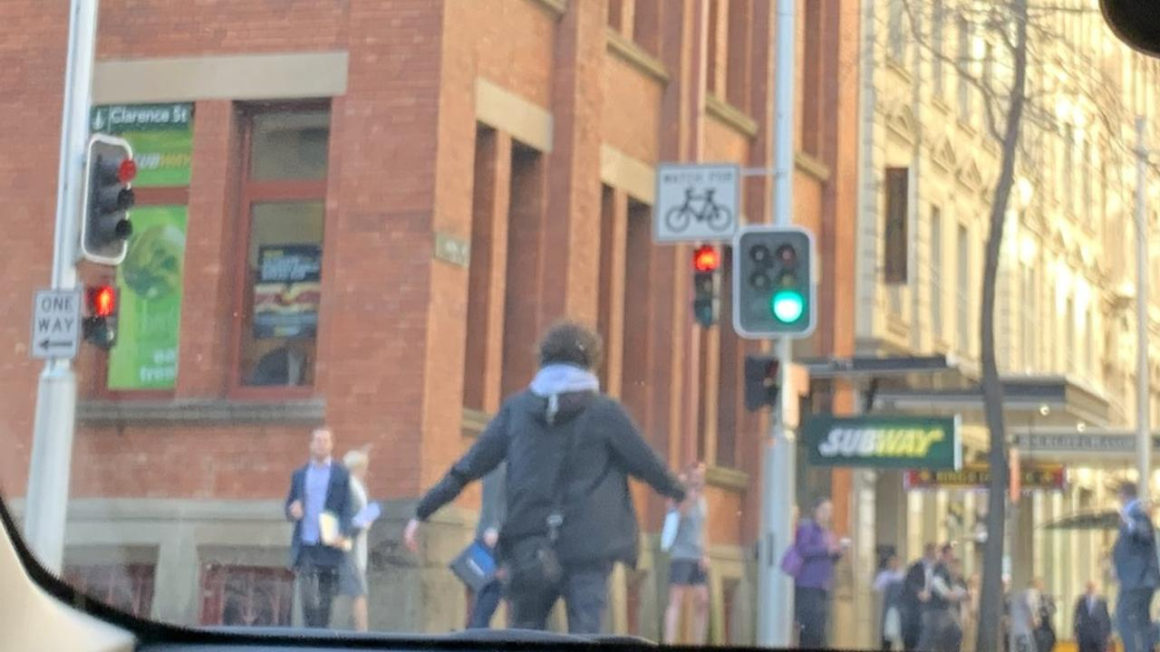 A man is seen brandishing a knife on Clarence Street. Picture: Twitter / @Ayusha77