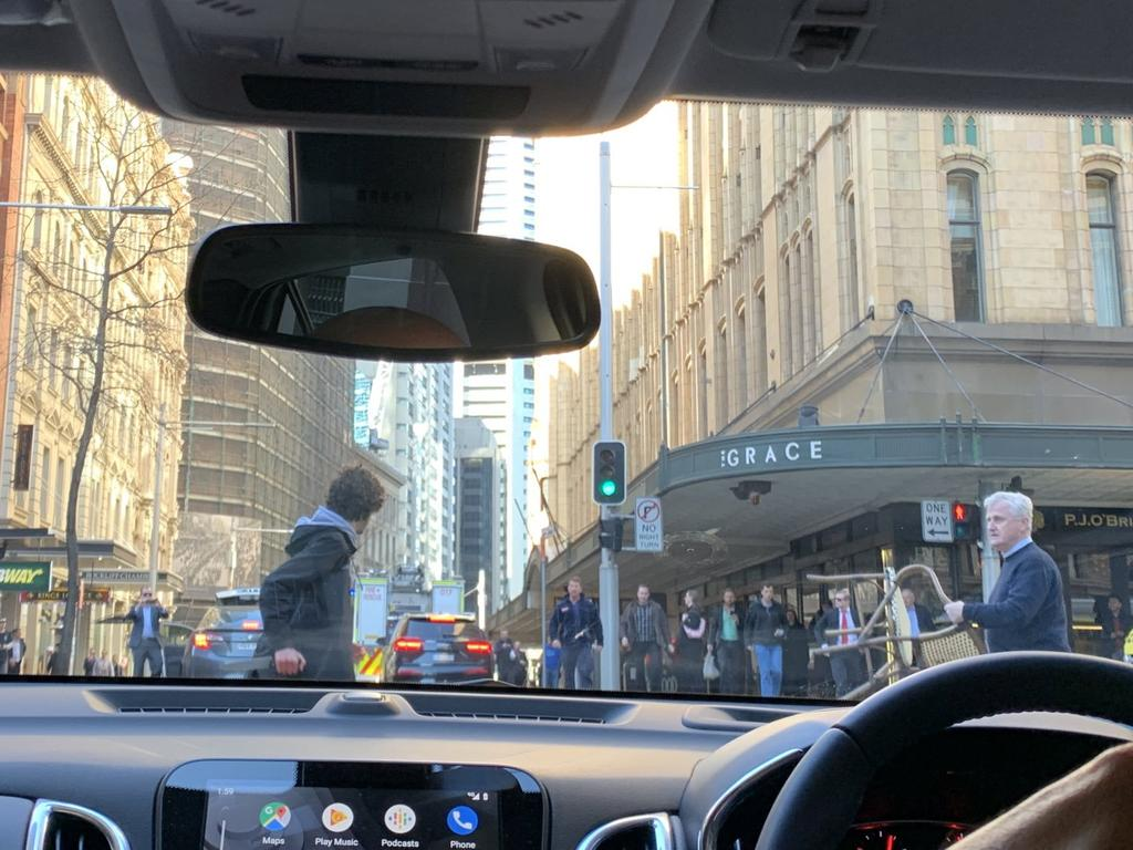 Another view from a driver inside their Mercedes Benz, where you can see the man wielding a knife on Clarence Street when he is confronted by a bystander with a chair trying to stop him. Picture: Twitter / @Ayusha77