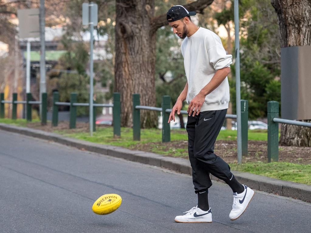 Ben Simmons plays footy in the MCG carpark. Picture: Jake Nowakowski