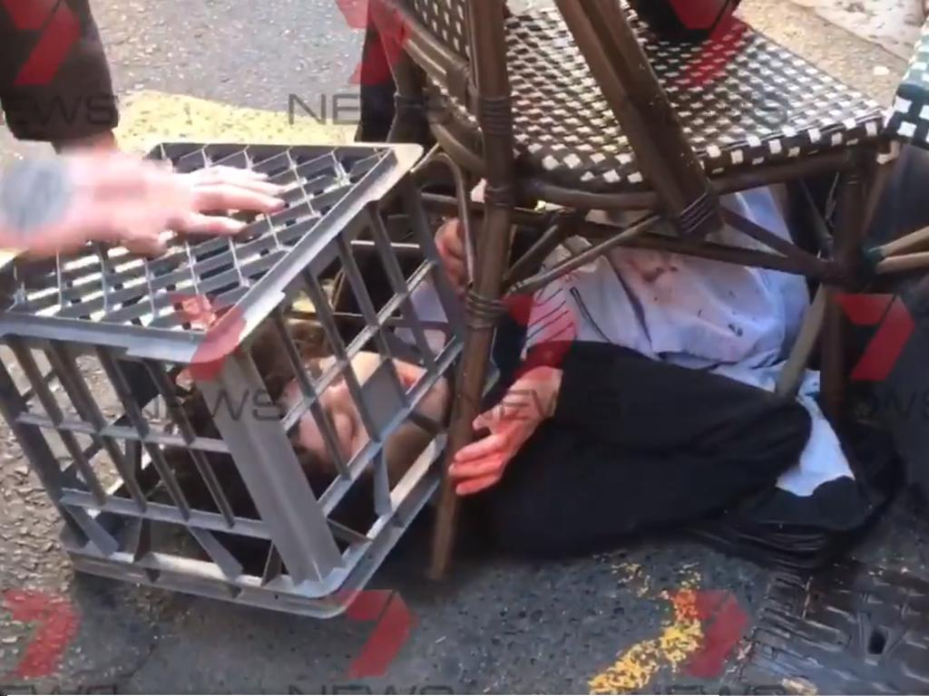 The young man is stopped in his tracks with a chair and a milk crate. Picture: Seven News
