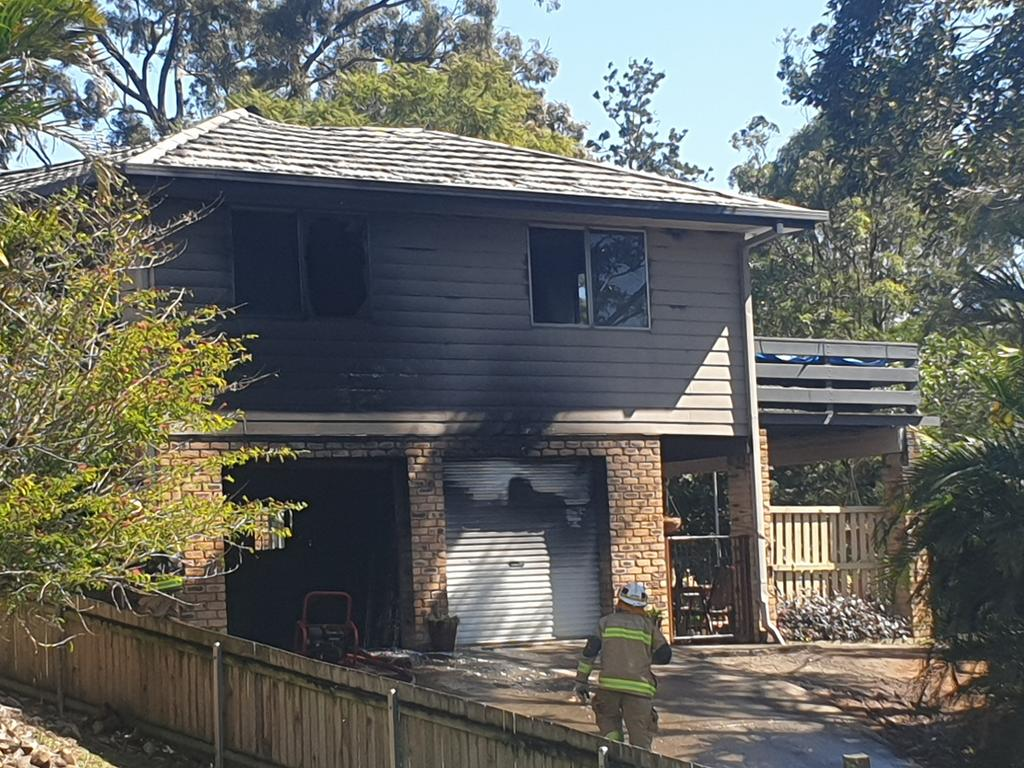 Fire crews from Beenleigh and Loganlea clean up following a house fire on Curve Avenue in Loganholme on Saturday morning. Picture: Jodie Munro O'Brien